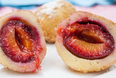 Delicious dumplings with plums on white plate Stock Images