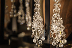 Delicious earrings for bride on dark background. Wedding details.  Stock Images