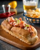 Lobster Roll with Celery and Mayonnaise. A delicious east coast lobster roll with celery and mayonnaise on a toasted bun Stock Photos