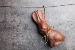 Delicious Easter chocolate bunny hanging on a string Royalty Free Stock Photos