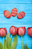 Delicious Easter cookies background with tulips royalty free stock images