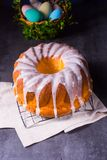 Delicious easter sand cake with white cake glaze. A delicious easter sand cake with white cake glaze stock images