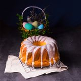 Delicious easter sand cake with white cake glaze. A delicious easter sand cake with white cake glaze stock image
