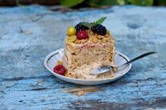 Delicious eaten berry cake on a white plate Stock Photos