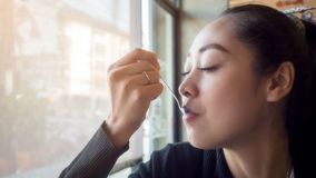 Delicious eating face. Asian woman eating with very delicious face Stock Photos