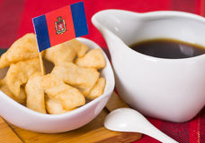 Delicious ecuadorian pristinos piled up in bowl, traditional andean pastry, cup of coffee siting on table, Quito flag Royalty Free Stock Photos