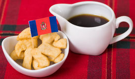 Delicious ecuadorian pristinos piled up in bowl, traditional andean pastry, cup of coffee siting on table, Quito flag Stock Photos