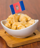 Delicious ecuadorian pristinos piled up in bowl, traditional andean pastry, cup of coffee siting on table, Quito flag Stock Photo