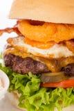 Delicious egg and bacon cheeseburger royalty free stock photos