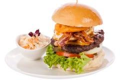 Delicious egg and bacon cheeseburger Royalty Free Stock Photography