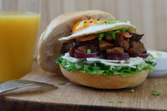 Delicious Egg Burger On Wooden Plate close view Stock Image