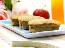 Delicious egg cake coffe flavor and red apple with milk and orange juice Stock Photo