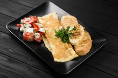 Delicious egg omelette with tomatoes and mozzarella. royalty free stock photo