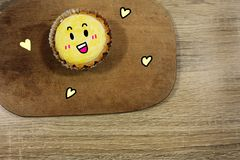Delicious Egg Tart with Smile Face Dessert on Wooden Table Background. Great For Any Use Royalty Free Stock Photos