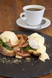 Eggs Florentine with bacon and coffee Stock Photography