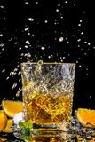 Delicious elite alcohol, rum whiskey tequila bourbon with splashes of droplets on a black background stock photos