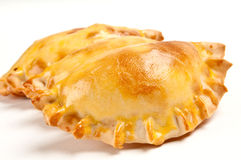 Delicious empanada. Group of Latin american empanadas. The Empanada is a pastry turnover filled with a variety of savory ingredients and baked or fried Royalty Free Stock Photography