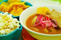 Delicious encebollado fish stew from Ecuador traditional food national dish closeup with popcorn Royalty Free Stock Photos