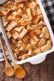 Delicious English bread pudding with raisins close up. Vertical Stock Photo