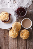Delicious English scones with jam and tea. vertical top view Royalty Free Stock Photo