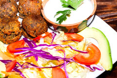 Delicious falafel plate with vegetables, vegetarian food Royalty Free Stock Photo