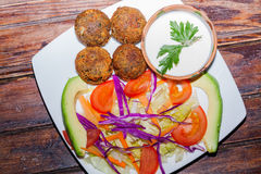 Delicious falafel plate with vegetables, vegetarian food Stock Images
