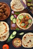Falafel wraps with spicy hummus and veggies stock photography