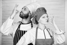 Delicious family dinner. Cooking with your spouse can strengthen relationships. Couple cooking dinner. Woman and bearded. Men culinary partners. Reasons couples stock image