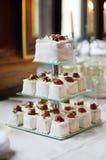 Delicious fancy wedding cake made of cupcakes Stock Photos