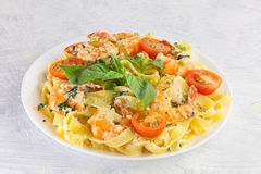 Delicious fettuccine pasta with prawns on white plate Royalty Free Stock Photo