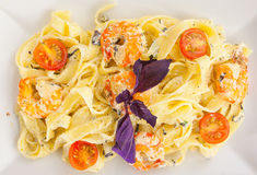 Delicious fettuccine pasta with prawns on white plate Royalty Free Stock Photos