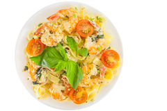 Delicious fettuccine pasta with prawns on white plate Stock Image