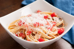 Delicious fettucini with mishrooms and tomatoes alfredo Royalty Free Stock Image