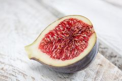 Delicious fig cut in half Royalty Free Stock Image