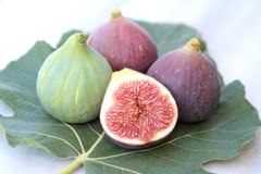 Delicious figs on a fig leaf Stock Images