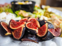Delicious figs in fruit salad. Delicious ripe  figs in fruit salad, ready to serve Stock Photography