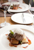 Delicious fillet beef. Roasted bone marrow, oxtail rilette,roasted potato gratin,sauted asaparagus,truffle foam and beef jus on a white plate as a main course Royalty Free Stock Photos