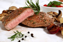 Delicious fillet steak white table Stock Photo
