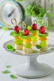 Delicious finger food with various fruits and mint for snack Stock Image