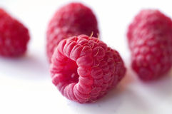 Delicious first class fresh raspberries isolated on white. Background - close up Royalty Free Stock Images