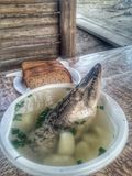 Delicious Fish soup from prey. Fish soup cooked from freshly caught Northern Pike, in a plate on a wooden table. Healthy and easy natural food Stock Photo