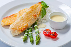 Delicious fish steak with green asparagus and rice Royalty Free Stock Photo