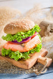 Delicious fishburger with salmon Royalty Free Stock Photography