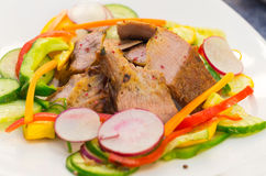 Delicious flank steak cuts cooked to perfection Stock Image