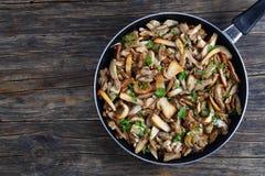 Fried Boletus mushrooms in frying pan Stock Photo