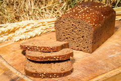 Delicious flavored bread on the background of dried hay Royalty Free Stock Image