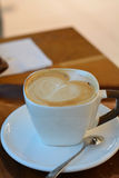 Delicious foamy cappuccino on the wooden table Stock Photo