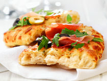 Delicious focaccia bread with ham and rocket Royalty Free Stock Image