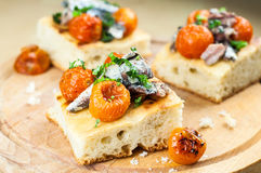 Delicious focaccia with sardines and cherry tomatoes Stock Images