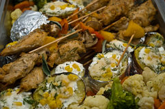 Delicious food. Delicious catering cooked food (filled potatoes and meat on sticks Royalty Free Stock Images
